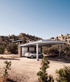 A carport stands apart from the home that David McAdam and Scott Smith built in the desert near Palm Springs, California, and is topped w...