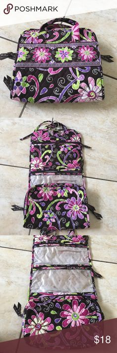 Vera Bradley folding make-up bag Very good condition. Barely shows wear and tear aside from make up marks (see photos) that can be easily removed and won't be seen when full. Many pockets and pouches. Folds and ties with convenient metal hook to hang. Vera Bradley Bags Cosmetic Bags & Cases
