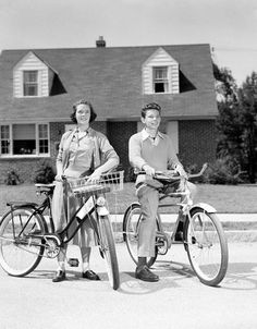 This is a picture shot in the 1959s of a couple bike riding in the suburbs. Many family moved to suburban areas because they thought it was a better place to raise children.