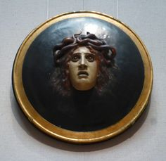 Head of Medusa, a scupture by Arnold Bocklin (Swiss, Papier mache and plaster. Open-mouthed head with coppery locks and snakes issuing from a domed black medallion with molded and gilt rim Sculpture Art, Sculptures, Medusa Gorgon, Dark Paintings, Museum Of Fine Arts, Les Oeuvres, Mythology, Snake, Pottery