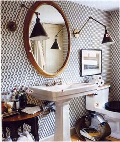 I love the wallpaper, wall sconces, and color scheme...basically everything!