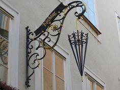 Unique Artistic Shop Sign in Austria for an umbrella shop.