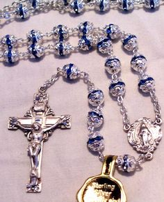 """Beautiful, quality 6mm Fancy Capped Sapphire bead, with Sterling Silver 1 1/2"""" crucifix and Miraculous center. Engraving available on crucifix only. Gift Boxed."""