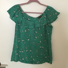 Anthropologie top Super cute turquoise top with hot air balloons; 100% silk; zips up the back Anthropologie Tops