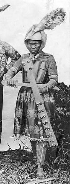 Philippine (Moro) warrior wearing helmet, mail and plate armor.