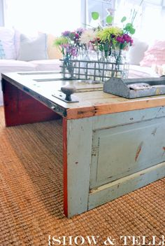 Old door turned coffee table - love that the knob and lock were kept on it! From Show & Tell Blog