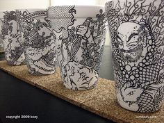 Styrofoam cup illustrations by Booey Creatively detailed illustrations on styrofoam coffee cups are made with a simple black Sharpie pen by an artist who was originally just looking for a surface to. Sharpie Cup, Arte Sharpie, Sharpie Markers, Sharpies, Coffee Cup Drawing, Coffee Cup Art, Coffee Shop, Paper Cup Design, Design Art