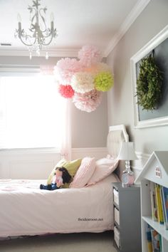 Make some lovely Tissue Pom Poms for your daughter's room, a nursery or an upcoming wedding or shower with this step-by-step tutorial | theidearoom.net