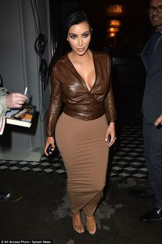 Kim Kardashian looked incredible in a brown ensemble as she headed out for a meal at Craig's restaurant in LA on Monday evening