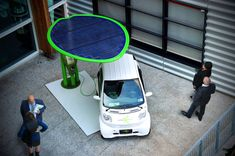 giancarlo zema realizes modular lotus system for luminexence -- this is a solar panel on a leaf-shaped collector that powers an EVSE (electric vehicle charging station)