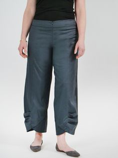 A go-to pant from Porto, this wide leg, cropped trouser features a high rise and wide waistband yoke. Hidden elastic within finished waistband, invisible front zip. Pleated tulip leg with architectural tucks at hemline to create a focal point. Cropped Trousers, Tulip, Hemline, Wide Leg, Capri Pants, Create, Clothes, Fashion, Porto