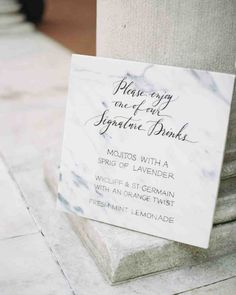 Marble Signage | Martha Stewart Weddings - With drink descriptions displayed on a marble poster board, guests at this wedding chose among three signature drinks: a mojito with lavender, fresh lemonade with mint leaves, and a Wycliff Brut Champagne and St-Germain combination with an orange twist.