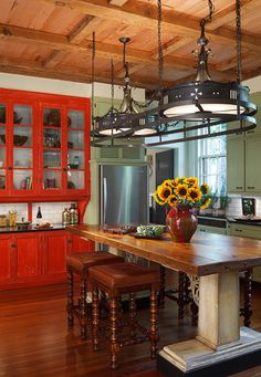 Old world kitchen with red cabinets!