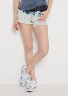 Set a course for adventure in this playful jean short! Fashioned with a flattering low rise fit, it features an ombre acid wash and decorative fraying at the leg openings. Standard waist construction.