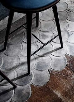 Fish scale scallops, in concrete, mingle with wood flooring at The Musket Room in NYC. Spotted on 79 Ideas. ------ seen on 15 Rooms with Scene Stealing Floors