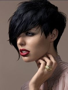 Black pixie razor cut, long in front