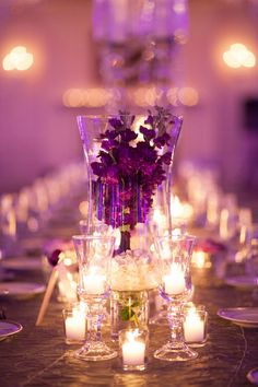 Centerpiece  I HAVE A REALLY LAREGE SILVER BASED GLASS HURRICANE THAT WE CAN PUT FLOWERS AROUND THE CANDLE THQT WOULD BE COOL ON THE WEDDING PARTY TABLE