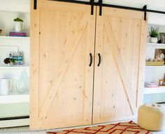 Installing interior barn door hardware can transform the look of your room. Read these steps in buying interior barn door hardware. Sliding Door Design, Double Barn Doors, Diy Barn Door, Sliding Barn Door Hardware, Sliding Doors, Barn Door Closet, Barn Door Track, Interior Doors For Sale, Interior Barn Doors