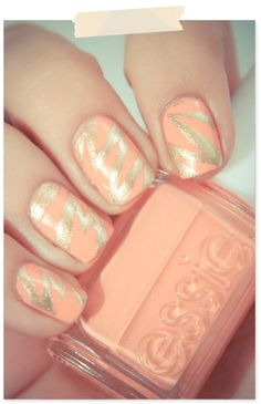Light coral nail polish base + zigzags of shimmering gold nail polish.