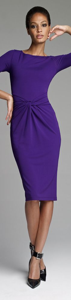 Gorgeous purple dress with twist at the waist. Perfect for the office.
