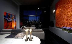 Katon Apartment 3 by David Katon. Beautiful use of grey as the backdrop.  Chic and elegance.