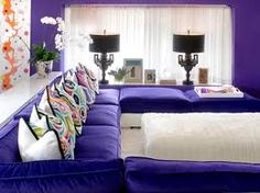 I could totally see myself doing this in my living room.  The pillows would have to change.