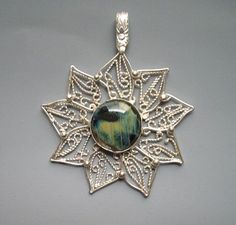 Filigree 9 pointed star pendant