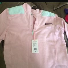 Pink vineyard vines jacket THE FIRST PICTURE IS NOT THE JACKET THE jACKET I HAVE JUST LOOKS LIKE IT the second picture is what the design in the shoulder looks like but it is pink all over Vineyard Vines Jackets & Coats
