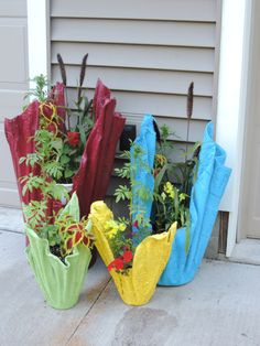 Cement Rag Planters - painted with Rustoleum indoor/outdoor pain Thicker, more absorbent towels/fleece make sturdier planters.  UPDATE:  THESE PLANTERS HAVE BEEN THROUGH 2 YEARS OF USE COMING UP ON 3.  SINCE MINE SIT OUTSIDE IN THE SUN AND RAIN I DO NEED TO TOUCH UP SPRAY PAINT A FEW FLAKY SPOTS EACH SPRING.  I ALSO PLACE A FEW HEAVY ROCKS IN THE BOTTOM AND USE DROP IN PLASTIC POTS TO HOLD THE PLANTS.