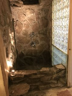 Best DIY IVE EVER DONE! Almost finished! Rock wall shower with NATURAL waterfall shower & rain shower HEAD and also has a bathtub area! Can't wait to turn it on and fill it up! This was an amazing DIY!