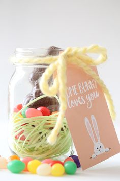 Edible Easter Bunny Mason Jars | Print out these adorable bunny tags and tie them to a mason jar full of Easter treats for an easy gift idea.