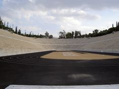 """The Panathinaiko or Panathenaic Stadium (Greek: Παναθηναϊκό στάδιο), also known as the Kallimarmaro (Καλλιμάρμαρο, i.e. the """"beautifully marbled""""), is an athletic stadium in Athens that hosted the first modern Olympic Games in 1896."""