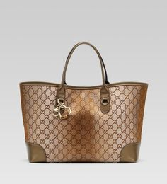 Gucci 'heart bit' medium tote with heart-shaped charm, bamboo detail, and hafl-horsebit