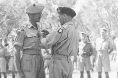 Maj. H. P. 'Budge' Bell-Irving, OC DSO CBE OBC ED CD, of the Seaforth Highlanders of Canada, receiving his DSO from Gen Sir B. Montgomery in Sicily, 1943. Bell-Irving, who later became BC's Lieutenant Governor, was awarded the DSO for his exemplary leadership of 'A' Coy. during the capture of Agira, 26-28 July, 1943.