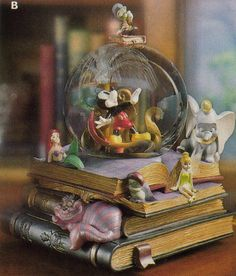 Disney snowglobe featuring Ariel, Tinkerbell, Dumbo and Mickey