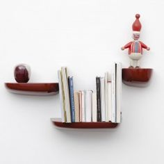 Floating shelves likt the Vitra Corniche Shelf give your interior an airy, spacious feel.