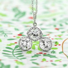 These cushion cut halo accessories will make the season extra bright! Antique Halo Pendant & Diamond Halo Earrings.