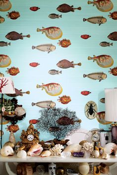 ACQUARIO's clownish fish, an early Fornasetti theme, were picked for their whimsical and naive appearance. Cole & Son Fornasetti II, available through Lee Jofa