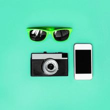 Fashion accessory. Sunglasses, vintage camera and smartphone on