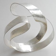 """Reiko Ishiyama- JAPAN  """"My work has an almost fragile quality, stressing lightness and mobility. By shaping paper thin sheets of silver, I can house space itself."""" Smithsonian Craft2Wear, Oct 1-3, 2015, Washington, DC.  http://swc.si.edu/craft2wear"""