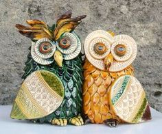 Large Owls Couple of La Terra Incantata Made entirely by hand, molded, hunched up, graffiti and stained with effect ceramic glazes and paints. Created using the ancient techniques of ceramic tradition of Grottaglie and enriched of new decorative expressions.