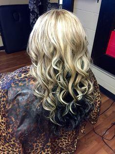 Hair by Heather. Heavy blonde highlight with brown lowlights . Dark underneath.