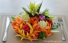 This food art bouquet has a combination of many fruits and vegetables such as carrots for some of the flower, onions, and payaya.