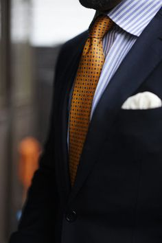 Navy jacket, white shirt with light blue candy stripes, orange tie with medallions #fashion&#style