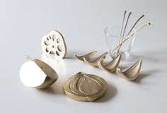 Inspired by kitchen chopping vegetables and fruit such as onions, lotus root, apple, etc., Cut Piece is a series copper kitchen accessories created by Graf