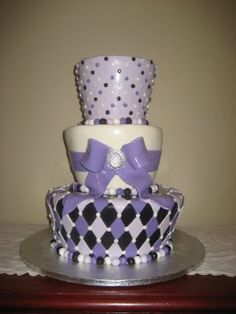 Meg can u do sumthin shaped like this ? Pretty purple birthday cake!