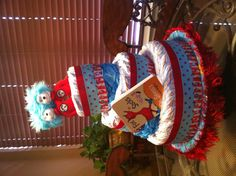 Dr. Suess themed diaper cake I made for Dr. Suess baby shower we are going to this weekend. Nursery is also Dr. Suess :)