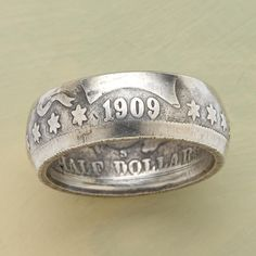 "HALF DOLLAR RING -- A vintage coin is hand worked into a ring still bearing the original markings. Coin silver. Made in the USA. Whole and half sizes 6-1/2 to 10, 11, 12, 13. Approx. 5/8""W."