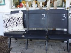 This attached folding seat has an industrial vibe with black paint and stenciled numbers.