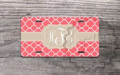 """Personalized Monogrammed License Plates - Coral quatrefoil pattern - Designed by """"- NestGiftCo -"""" adds a great style to your vehicle.  Our car tags are made of aluminum and are made through a process called sublimation. Gelled dyes are spritzed onto a specially coated paper. An aluminum plate i..."""